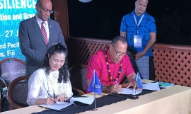 Ms Tomoko Nishimoto, ILO Regional Director for Asia Pacific (L) and Mr. Kosi Latu, SPREP Director General (R), signing a new partnership.